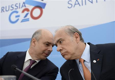 Angel Gurria, secretary-general of the Organisation for Economic Co-operation and Development (OECD), and Russia's Finance Minister Anton Siluanov attend a briefing at the G20 Summit in Strelna