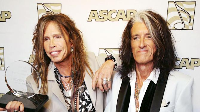 FILE - In this April 8, 2013 photo, Steven Tyler, left, and Joe Perry, recipients of the ASCAP Founders Award, pose with their awards at the ASCAP Press Conference held at the Sunset Marquis, in Los Angeles. Tyler and Perry will be honored with the award during ASCAP's 30th annual Pop Music Awards at a gala on April 17, 2013, in Los Angeles. (Photo by Eric Charbonneau/Invision/AP, File)