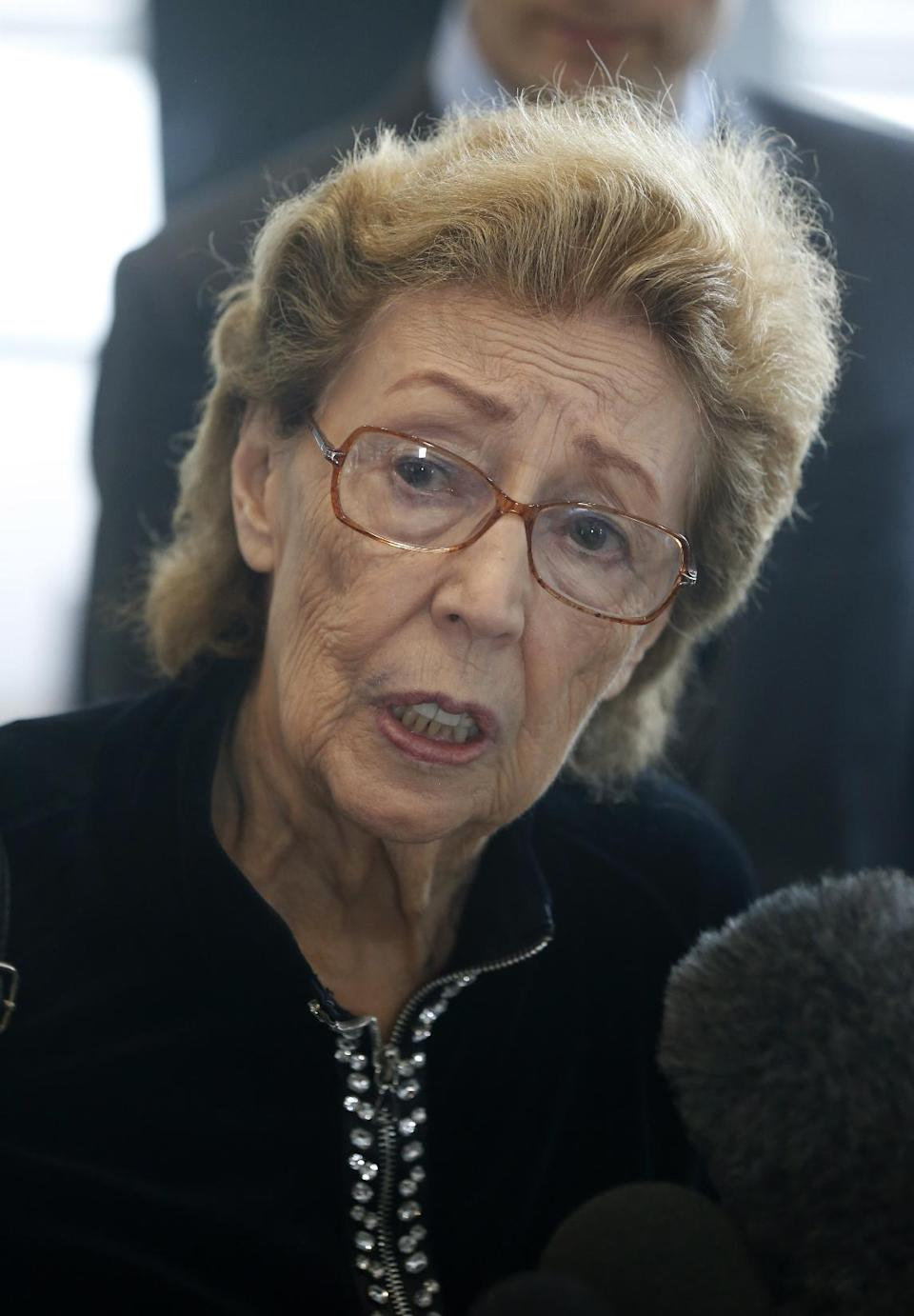 Jacqueline Goldberg responds to a reporters' question after a federal jury returned with a finding in Donald Trump's favor in her civil case alleging that the real estate mogul cheated her in a skyscraper condo deal, Thursday, May 23, 2013 in Chicago. (AP Photo/Charles Rex Arbogast)