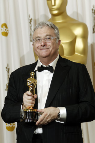 FILE - This Feb. 27, 2011, file photo shows composer Randy Newman posing backstage with the Oscar for best original song for We Belong Together&quot; from Toy Story 3&quot; at the 83rd Academy Awards in the Hollywood section of Los Angeles. Newman is weighing in on the presidential election, and he&#39;s playing the race card through a song he wrote. Im Dreaming is full of satirical, sarcastic _ and signature Newman _ anecdotes about someone who votes for the president because he is white. It features the refrain: Im dreaming of a white president. Newman is openly supporting President Barack Obama. He says though the song is serious, he wants the public to find comedic relief in it. (AP Photo/Matt Sayles, File)