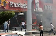"Lebanese men ransack US fast food chains Hardee's and KFC as they protest against the controversial film ""Innocence of Muslims"" in the northern city of Tripoli. Pope Benedict XVI landed in Lebanon on Friday to start a three-day visit, saying the multi-faith country could serve as an example to a troubled Middle East but with his message marred by a deadly Islamist protest"