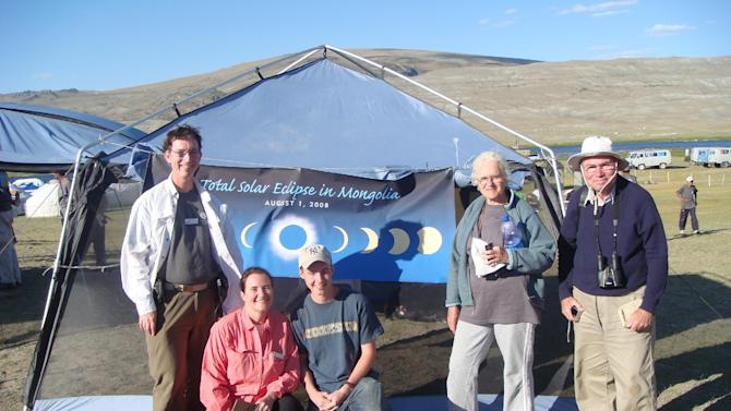 This 2008 photo supplied by Linda Bugbee shows, from left, her husband George, herself, and Dali and Eli Maor, in Mongolia where they had traveled to watch a solar eclipse. The Bugbees are traveling to watch their fourth solar eclipse on Nov. 14 in Cairns, Australia, where some 50,000 tourists are expected to see the phenomenon. (AP Photo/courtesy of Linda Bugbee)