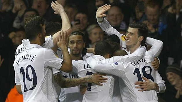 Tottenham celebrate Gareth Bale's early opener against Inter Milan (Reuters)