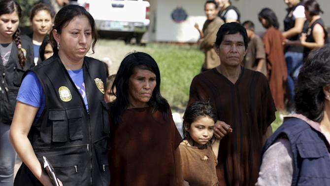 Peruvian anti-terrorist forces escort a group of rescued people from Shining Path rebels at Mazamari military base in the Amazon province of Satipo