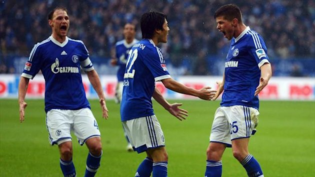 Schalke players celebrate against Borussia Dortmund (Reuters)