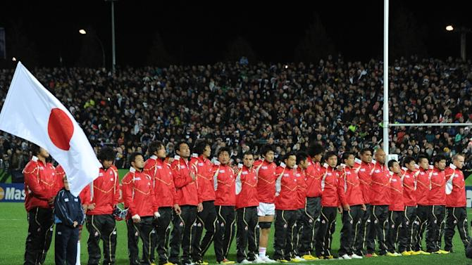 Japan's team observes a minute of silence for victims of the earthquake and tsunami which hit Japan before the 2011 Rugby World Cup pool A match New Zealand vs Japan at Waikato stadium in Hamilton