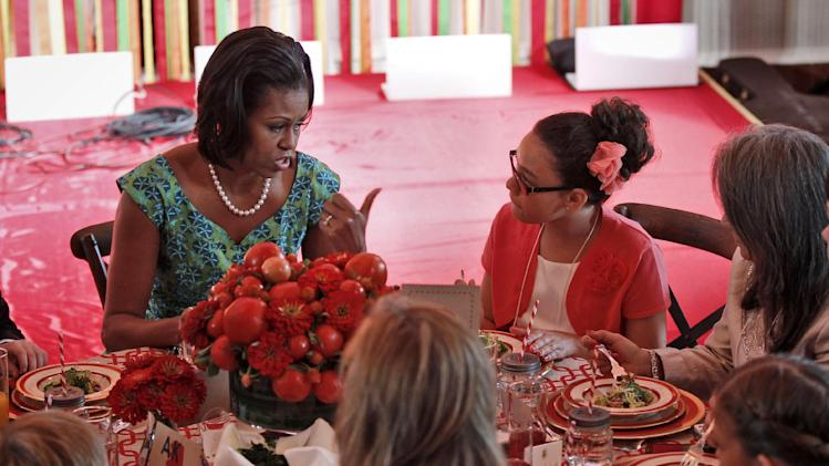 """First lady Michelle Obama talks with Illana Gonzalez-Evans, from Washington, during the Kids' """"State Dinner,""""  Monday, Aug. 20, 2012, in the East Room of the White House in Washington. (AP Photo/Pablo Martinez Monsivais)"""