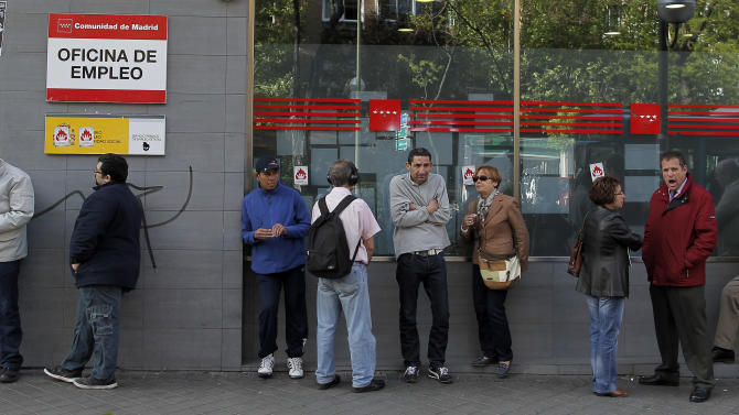 People queue outside an office to register for job placement in Madrid, Spain Thursday April 25, 2013. Spain's National Statistics Institute said the country's unemployment rate shot up to a record 27.2 percent in the first quarter of 2013 taking the total to 6.2 million. Spain is in recession again as it struggles to deal with the collapse of its once-booming real estate sector in 2008. (AP Photo/Andres Kudacki)
