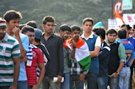 Indian cricket fans wait in line outside The M. Chinnaswamy Stadium in Bangalore on December 25, 2012. Police were out in full force in the southern Indian city as part of a massive security operation ahead of Pakistan&#39;s first cricket tour of India for five years