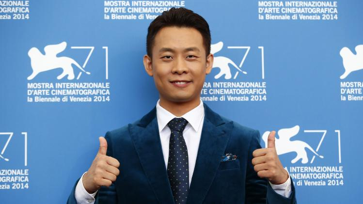 "Chinese actor Zhang Yi poses during the photocall for the movie ""Qin'ai de"" at the 71st Venice Film Festival"