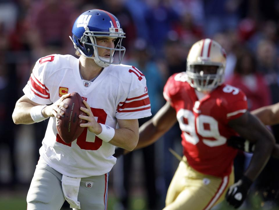 New York Giants quarterback Eli Manning (10) prepares to throw as San Francisco 49ers linebacker Aldon Smith (99) moves in during the second quarter of an NFL football game in San Francisco, Sunday, Nov. 13, 2011. (AP Photo/Ben Margot)