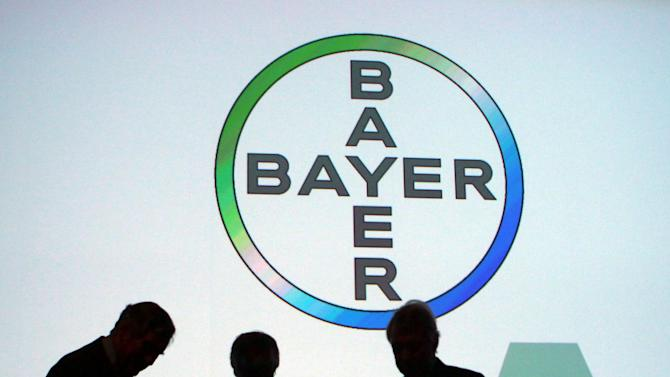 File photo of people standing under a Bayer AG logo in Cologne, Germany