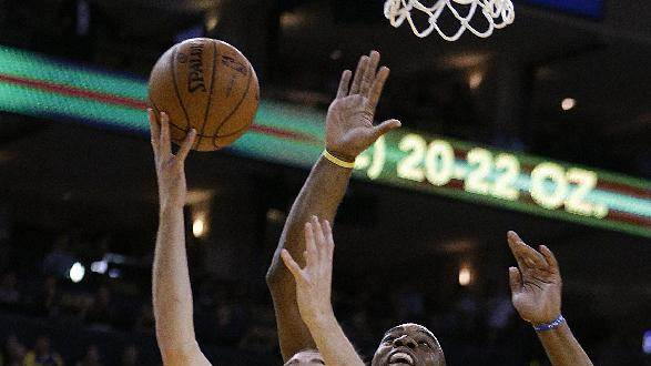 San Antonio Spurs' Nando De Colo (25) lays up a shot against Golden State Warriors' Carl Landry during the first half of an NBA basketball game Friday, Feb. 22, 2013, in Oakland, Calif. (AP Photo/Ben Margot)