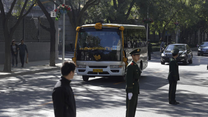 A mini-bus carrying the casket with former Cambodian King Norodom Sihanouk leaves from the Beijing hospital for the airport in Beijing, China, Wednesday, Oct. 17, 2012. Sihanouk died Monday at age 89 of a heart attack in Beijing, where he had been receiving medical treatment since January for multiple ailments. His body will be flown back to Phnom Penh Wednesday. (AP Photo/Ng Han Guan)