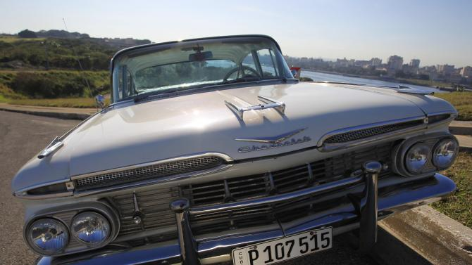 A 1959 Chevrolet Impala car is parked in Havana