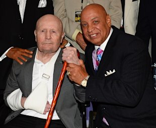 Former boxing referee Mills Lane (L) and boxing referee Joe Cortez at their induction into the Nevada Boxing Hall of Fame on Aug. 10, 2013 in Las Vegas, Nevada. (Photo by Ethan Miller/Getty Images)