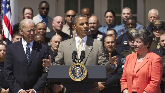 President Barack Obama, center, with Vice President Joe Biden, left, and Homeland Security Secretary Janet Napolitano, makes his remarks honoring the 2012 National Association of Police Organizations TOP COPS award winners in the Rose Garden at the White House, Saturday, May 12, 2012.  (AP Photo/Manuel Balce Ceneta)