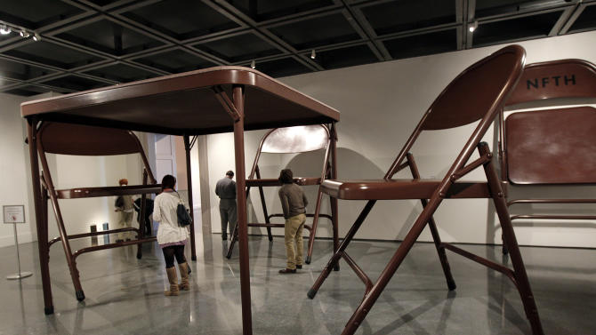 "In this Wednesday, Nov. 14, 2012 photo, giant folding tables and chairs are part of the untitled installation by artist Robert Therrien on display at the New Orleans Museum of Art,  in New Orleans, Wednesday, Nov. 14, 2012. The installation is part of ""Lifelike,"" a traveling exhibit at the New Orleans Museum of Art through Jan. 27. (AP Photo/Gerald Herbert)"