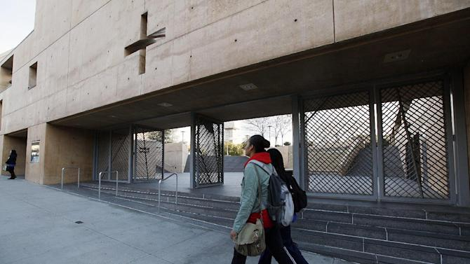 Students walk past the Cathedral Of Our Lady Of Angels the seat of the Archdiocese of Los Angeles on Friday Feb. 1,2013 . Cardinal Roger Mahony, who retired with a tainted career after dodging criminal charges over how he handled pedophile priests, was stripped of duties by his successor as a judge ordered confidential church personnel files released. (AP Photo/Nick Ut)