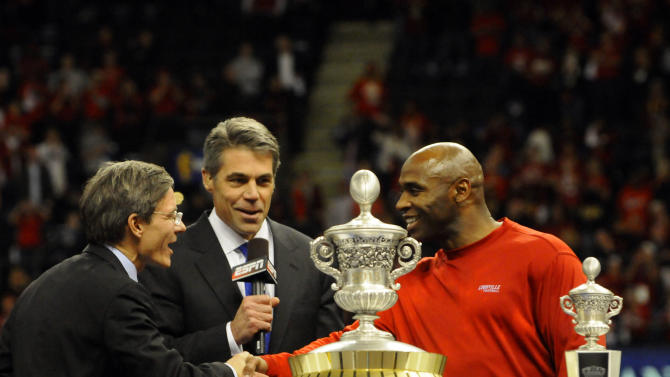 IMAGE DISTRIBUTED FOR ALLSTATE- Allstate Insurance CEO Tom Wilson, left, congratulates Louisville head coach Charlie Strong, right, with ESPN's Chris Fowler, center, after the Cardinals beat the Florida Gators, 33-23, in the 2013 Allstate Sugar Bowl at the Mercedes-Benz Superdome in New  Orleans on Jan. 2, 2013. (Cheryl Gerber/AP Images for Allstate)