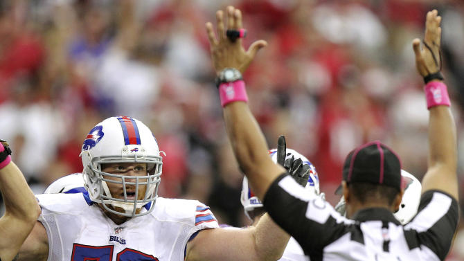 Buffalo Bills tackle Erik Pears (79) signals touchdown along with line judge Ron Phares (10) during the second half of an NFL football game against the Arizona Cardinals, Sunday, Oct. 14, 2012, in Glendale, Ariz. (AP Photo/Paul Connors)