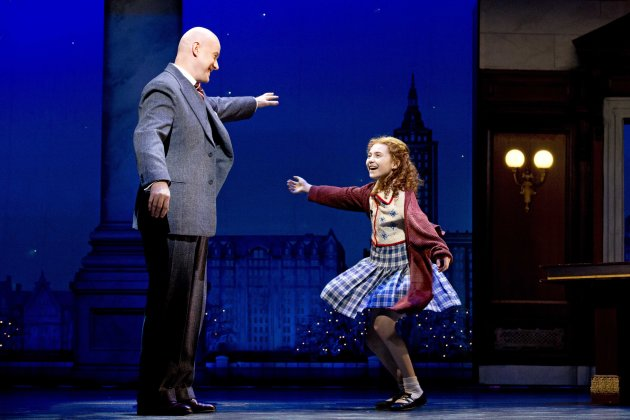 "This theater image released by Boneau/Bryan-Brown shows Anthony Warlow as Daddy Warbucks, left, with Lilla Crawford in the title role of the musical ""Annie,"" in New York. (AP Photo/Boneau/Bryan-Brown, Joan Marcus)"
