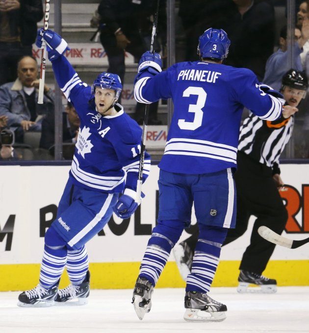Toronto Maple Leafs McClement celebrates his goal with teammate Phaneuf against the Ottawa Senators during the first period of their NHL hockey game in Toronto
