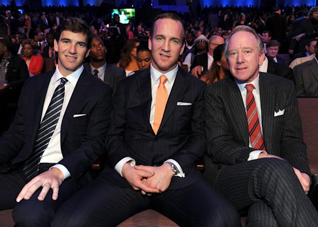 Eli Manning of the New York Giants, left, Peyton Manning of the Denver Broncos, center, and former NFL player Archie Manning at the 2nd Annual NFL Honors on Saturday, Feb. 2, 2013 in New Orleans. (Pho