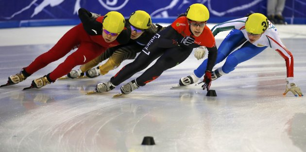 Wang of China, Sakai of Japan, Maltais of Canada and Valcepina of Italy compete during the women's 1000m quarterfinals at the ISU World Short Track Speed Skating Championships in Debrecen