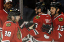 Chicago Blackhawks&amp;#039; Patrick Kane (88) celebrates with teammates after scoring a goal against the Detroit Red Wings during the first period of Game 2 of an NHL hockey Stanley Cup playoffs Western Conference semifinals Saturday, May 18, 2013, in Chicago. (AP Photo/Nam Y. Huh)