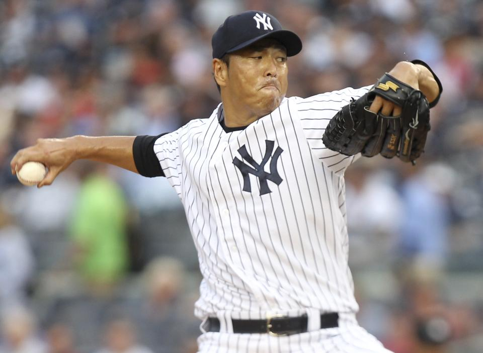 New York Yankees' Hiroki Kuroda pitches during the first inning of the baseball game against the Texas Rangers on Tuesday, Aug. 14, 2012, at Yankee Stadium in New York.  (AP Photo/Seth Wenig)