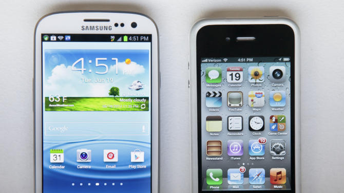 This June 19, 2012 photo shows Samsung's new Galaxy S III phone, left, next to an iPhone 4S in New York. The Galaxy S III, which looks and feels like an oversized iPhone, is available next week. (AP Photo/Bebeto Matthews)
