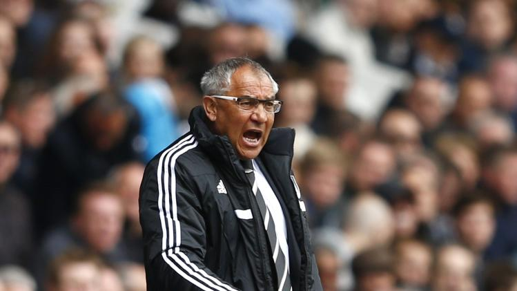 Fulham manager Magath reacts during their English Premier League soccer match against Tottenham Hotspur at White Hart Lane in London