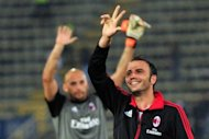 AC Milan&#39;s Giampaolo Pazzini (R) celebrates at the end of their Serie A match vs Bologna at the &#39;Dallara Stadium&#39; in Bologna, on September 1. AC Milan play Atalanta next, on Saturday