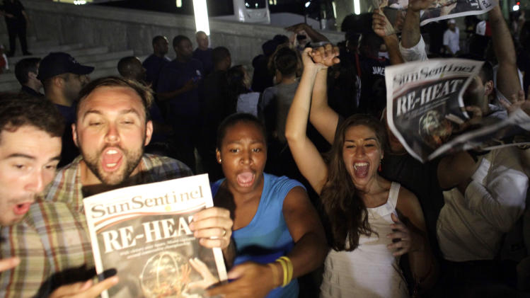Miami Heat fans celebrate the Championship after the Heat's win against the San Antonio Spurs after the Game 7 of the NBA final basketball series in Miami on Friday, June 21, 2013.. The Heat beat the San Antonio Spurs 88-95 to win to their second straight title. (AP Photo/Javier Galeano)