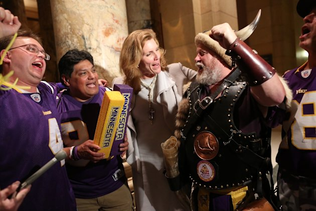 Sen. Julie Rosen, the author of the stadium bill, celebrated the passage of the bill with a few Vikings fans outside the Senate chambers late Tuesday night, May 8, 2012 at the Capitol in St. Paul, Minn. (AP Photo/Renee Jones Schneider, star-tribune)