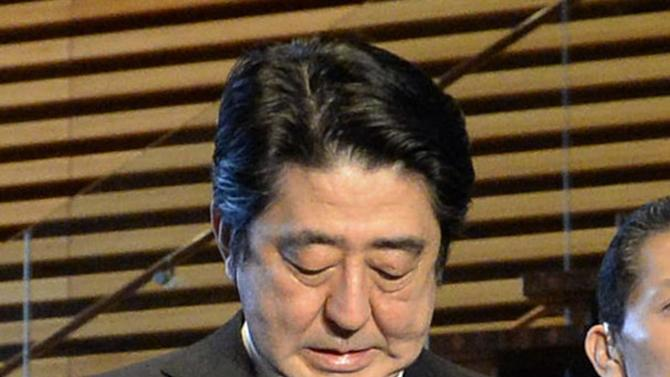 Japanese Prime Minister Shinzo Abe speaks to reporters at the prime minister's official residence in Tokyo early Sunday, Feb. 1, 2015 after an online video released Saturday night purported to show an Islamic State group militant beheading Japanese journalist Kenji Goto. (AP Photo/Kyodo News) JAPAN OUT, MANDATORY CREDIT
