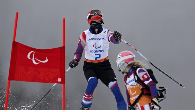 Slovakia's Kubacka is led by his guide Karpisova during the Men's Visually Impaired Skiing event of the Giant Slalom at the 2014 Sochi Paralympic Winter Games at the Rosa Khutor Alpine Center