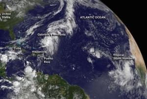 Tropical storm Humberto and the remnants of tropical storm Gabrielle near the Bahamas are shown in NOAA's GOES-East satellite image
