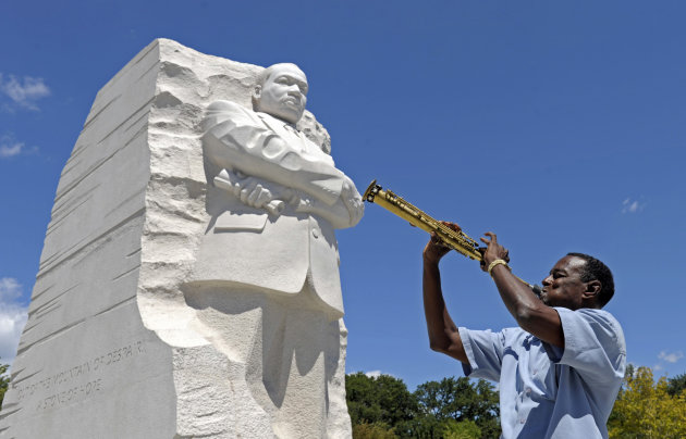 "James ""Plunky"" Branch plays his soprano saxophone near the new Martin Luther King, Jr., Memorial in Washington, Monday, Aug. 22, 2011. (AP Photo/Susan Walsh)"