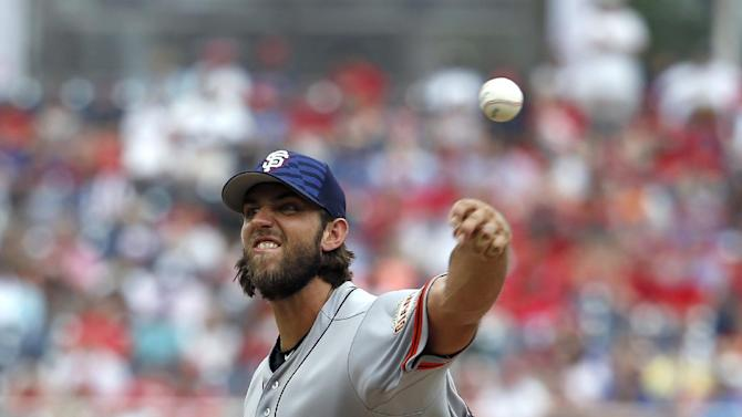 San Francisco Giants starting pitcher Madison Bumgarner (40) throws during the fourth inning of a baseball game against the Washington Nationals at Nationals Park, Saturday, July 4, 2015, in Washington. (AP Photo/Alex Brandon)