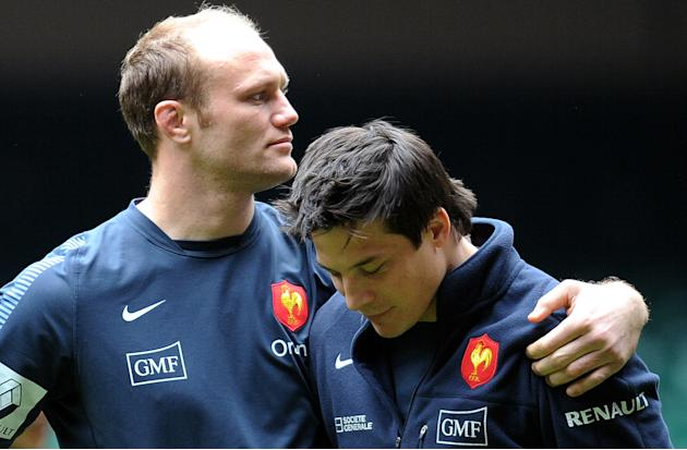 France's rugby union national team's flanker Julien Bonnaire (L) speaks with fly half Francois Trinh Duc (R) before a training session on March 16, 2012 at the Millenium stadium in Cardiff, on the eve
