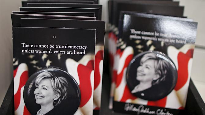 Hillary Clinton badges are seen for sale at the Clinton Museum Store in Little Rock
