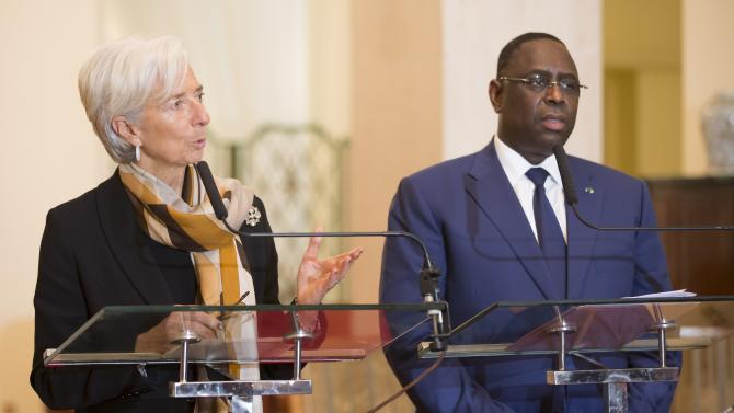 IMF Managing Director Christine Lagarde and Senegal's President Macky Sall hold a joint press conference after a meeting in Dakar
