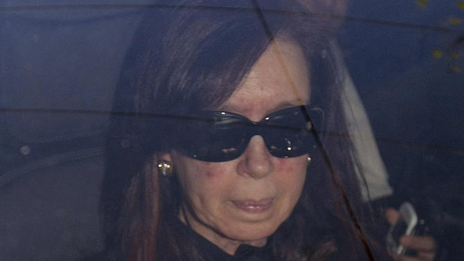 """ALTERNATIVE CROP TO EDB101 - Argentina's President Cristina Fernandez arrives to a local hospital, in Buenos Aires, Argentina, Monday, Oct. 7, 2013. Argentine president is back in the hospital, presumably for more treatment of the head injury that prompted doctors to order a month's rest. Her car entered the Fundacion Favaloro hospital on Monday, as Cabinet members gathered without her in the government palace for a speech by Vice President Amado Boudou, who wished her strength and said they would carry on, """"giving her the rest she deserves."""" (AP Photo/DyN, Pablo Molina)"""