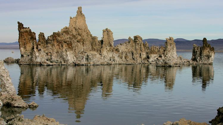 FILE - This Nov. 15, 2004, file photo, shows tufa towers in Mono Lake near Lee Vining, Calif. The ancient towers, composed of calcium carbonate, were formed underwater when fresh water springs mixed with minerals in the lake water, and became visible when lake water receded over the past 60 years due to water diversion to Los Angeles. In 2010 scientists reported that some bacteria taken from Mono Lake could thrive on arsenic instead of the usual elements needed to sustain life. Now two new studies released Sunday, July 8, 2012, cast doubt on those results. The new research papers say the original conclusion is wrong and that the bacteria do indeed still need phosphorus. (AP Photo/Ben Margot, File)