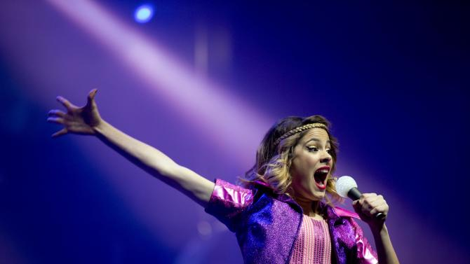 """FILE - In this July 23, 2013 file photo, Disney Channel star Martina Stoessel, of Argentina, performs in concert as """"Violetta,"""" her character from the Disney Channel television series of the same name, in Buenos Aires, Argentina. """"Violetta"""" is a major hit for Disney-Latin America and fans are flocking to the city's Palermo district Friday, May 2, 2014 for a free concert by the 17-year-old Argentine singer and actress who has seen her fame skyrocket since Disney picked her for the role. (AP Photo/Natacha Pisarenko, File)"""