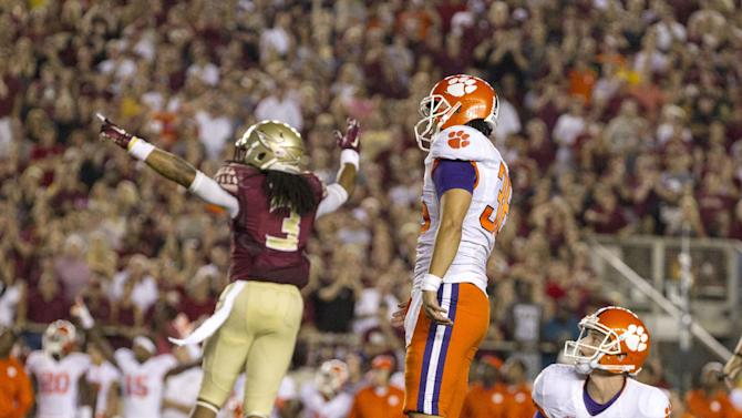 Florida State defensive back Ronald Darby, left, celebrates   a missed field goal by Clemson's Ammon Lakip, center, while holder Corbin Jenkins looks on in the second half of an NCAA college football game in Tallahassee, Fla., Saturday, Sept. 20, 2014.  Florida State defeated Clemson 23-17 in overtime.  (AP Photo/Mark Wallheiser)