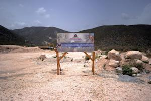 A sign advertises the future site of a center being…
