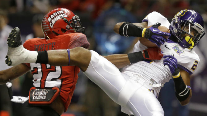 East Carolina wide receiver Justin Hardy (2) catches a touchdown pass as Louisiana-Lafayette cornerback Melvin White (22) defends in the first half of the New Orleans Bowl, an NCAA college football game in New Orleans, Saturday, Dec. 22, 2012. (AP Photo/Bill Haber)